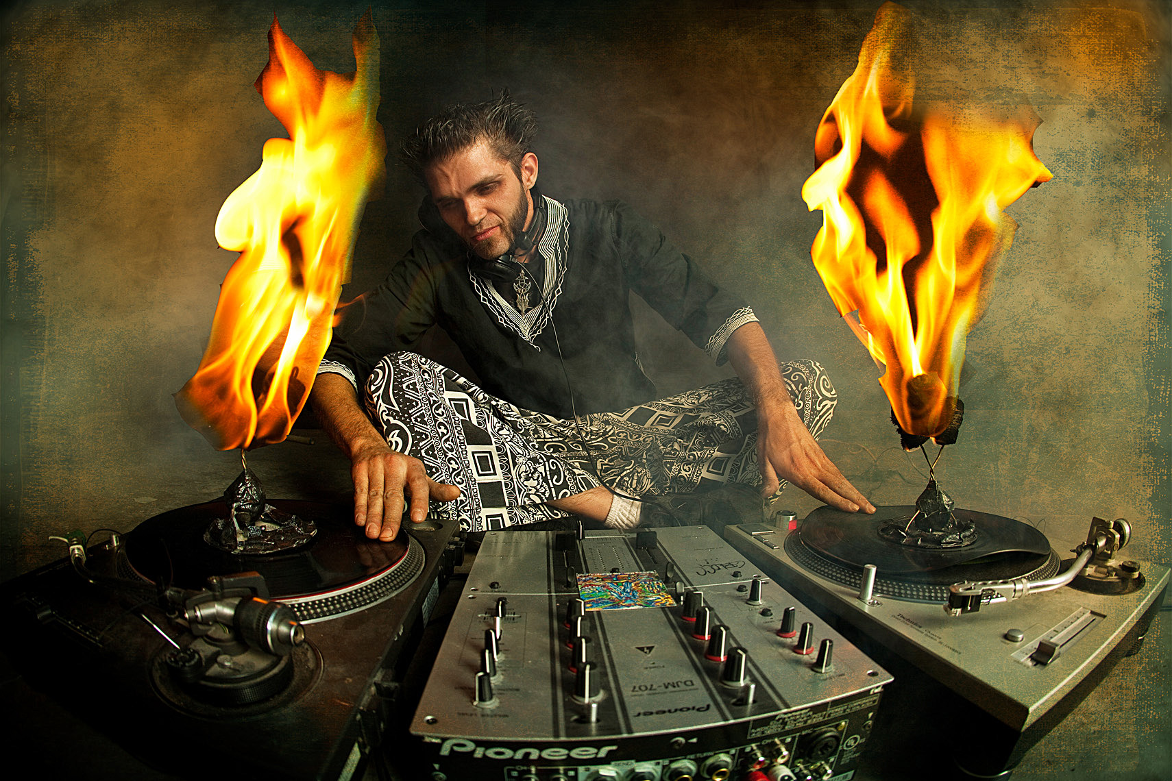 gritty textured DJ spinning fire Fire Dancers