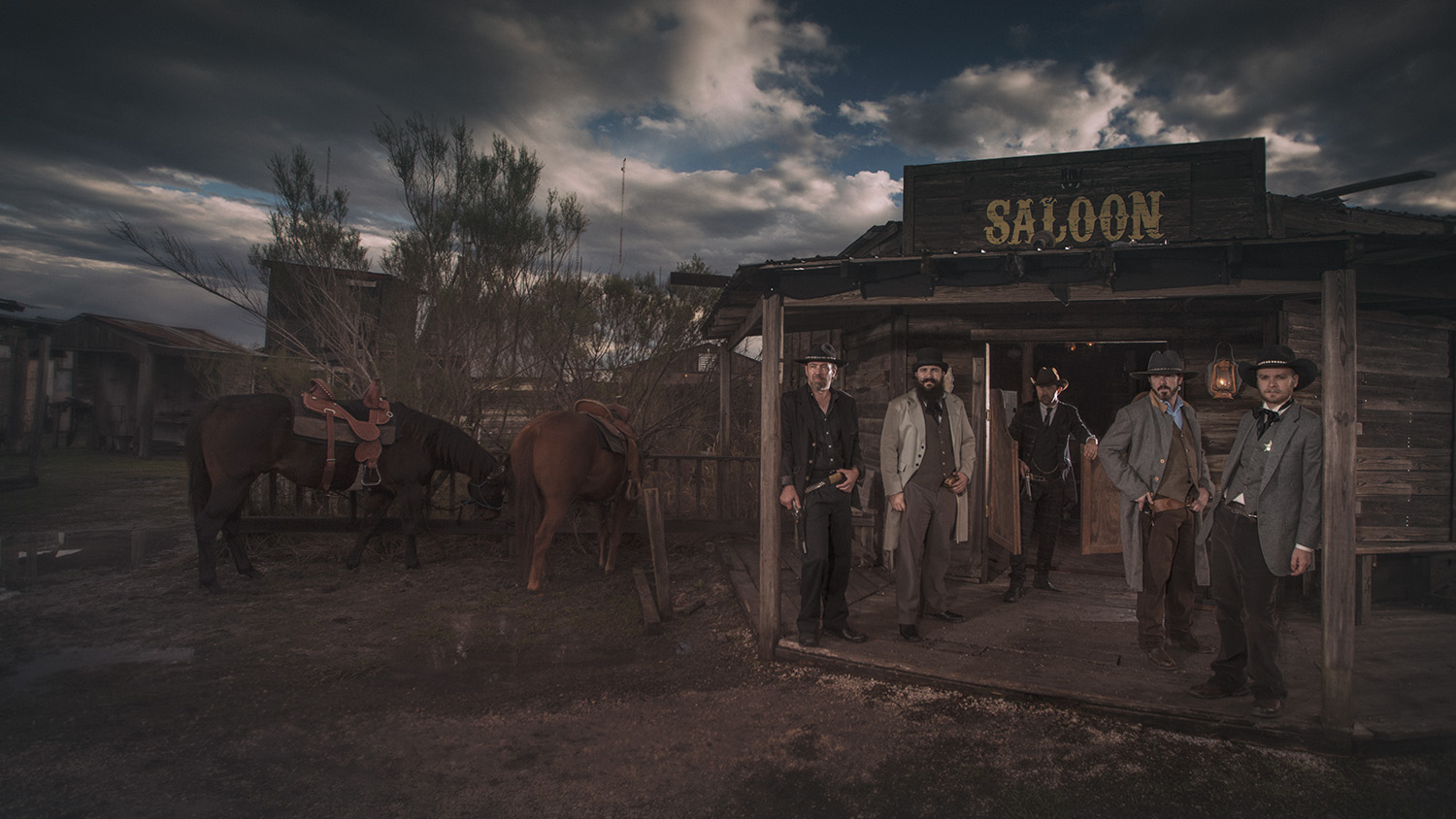 gang of men outside saloon western Old Western