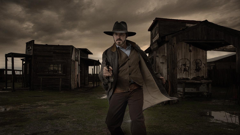 western cowboy pulling gun Wild West at J Loraine Ghost Town