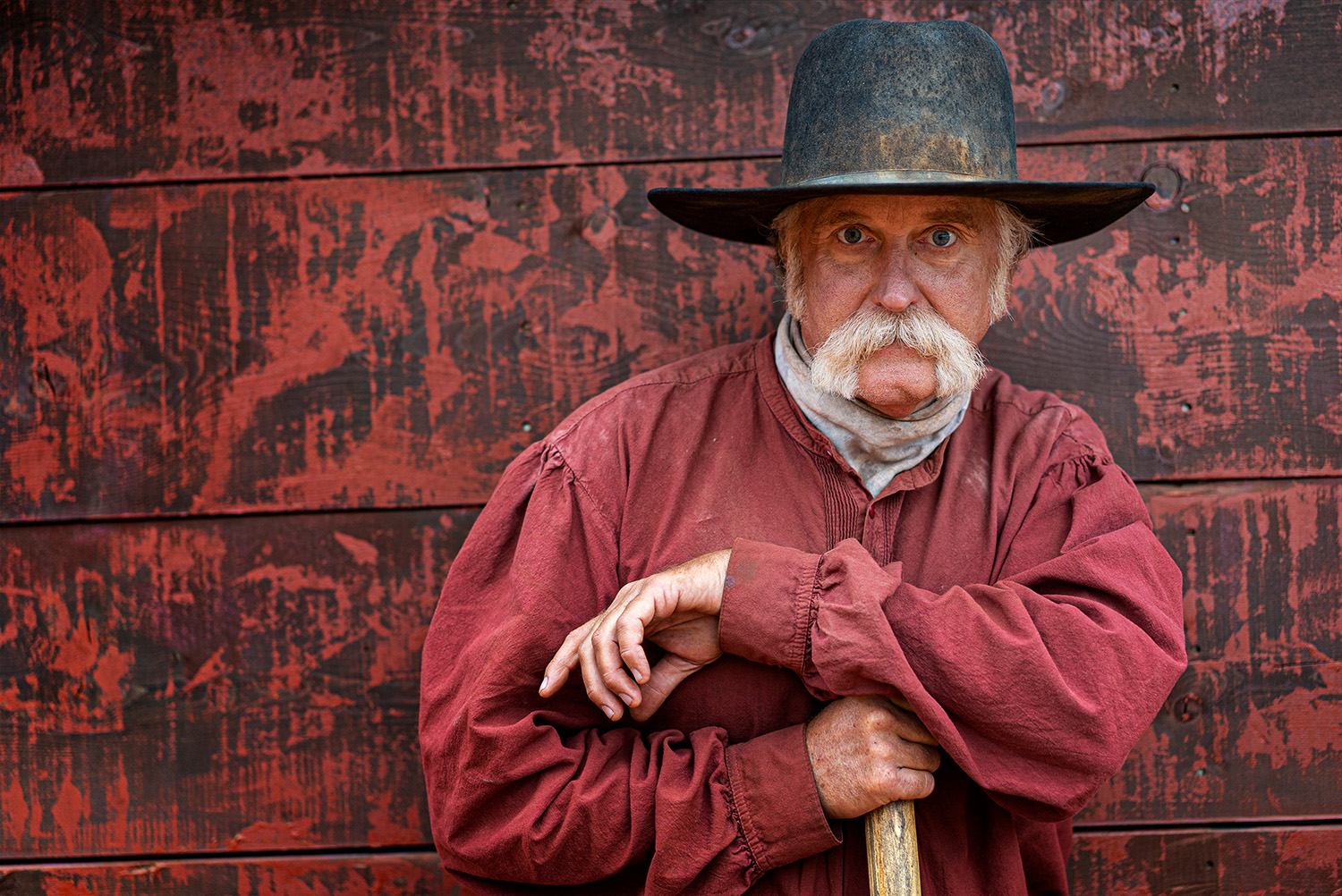 portrait of western man redbackground Portraits